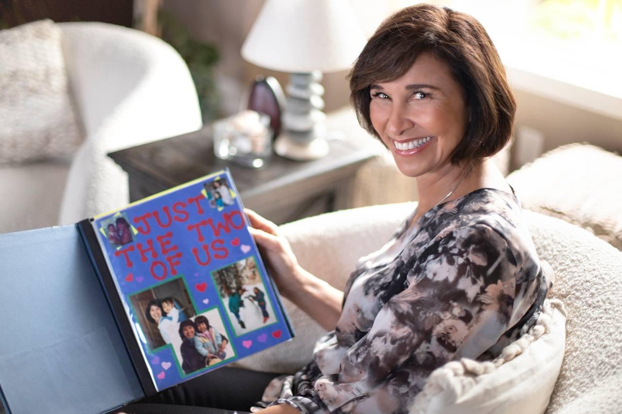 Joanna holding a family photo album